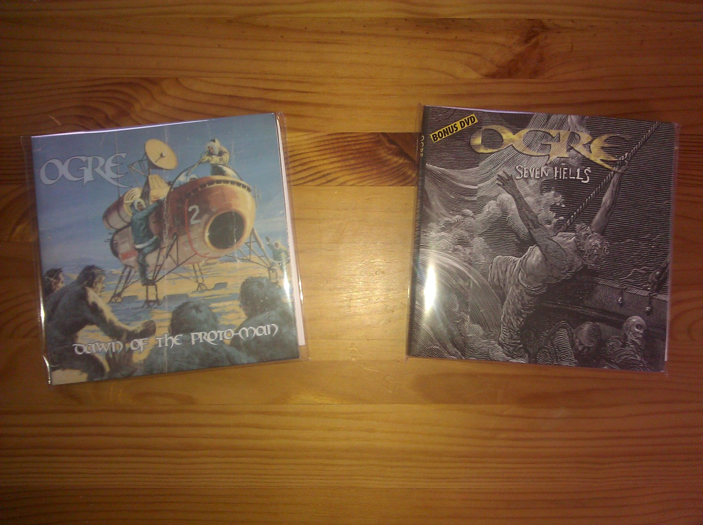 ogre dawn of the proto-man and seven hells cds