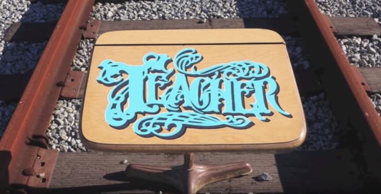 teacher logo on desk